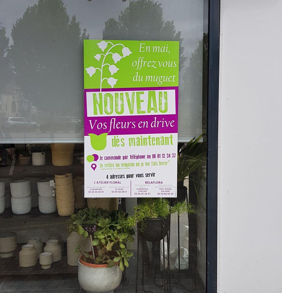 adhesif grand format vitrine l'atelier floral le neubourg le havre gonfreville eure normandie